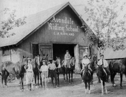 Stables with the words Avondale Riding School painted on the front